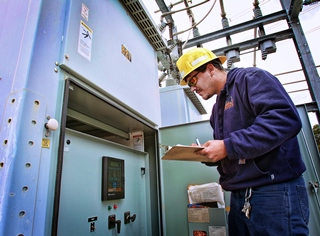 Utilities employee performing an inspection